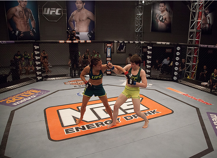 LAS VEGAS, NV - AUGUST 5:  (L-R) Team Pettis fighter Jessica Penne punches team Pettis fighter Aisling Daly during filming of season twenty of The Ultimate Fighter on August 5, 2014 in Las Vegas, Nevada. (Photo by Brandon Magnus/Zuffa LLC/Zuffa LLC via Ge
