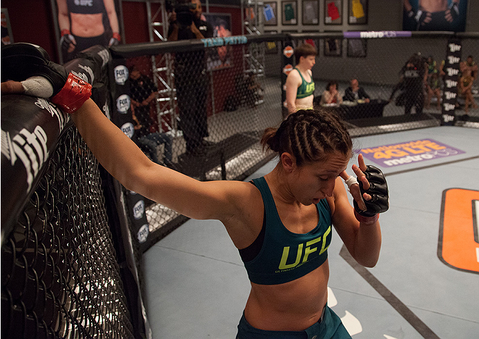 LAS VEGAS, NV - AUGUST 5:  Team Pettis fighter Jessica Penne steps to the side after an accidental eye poke from team Pettis fighter Aisling Daly during filming of season twenty of The Ultimate Fighter on August 5, 2014 in Las Vegas, Nevada. (Photo by Bra