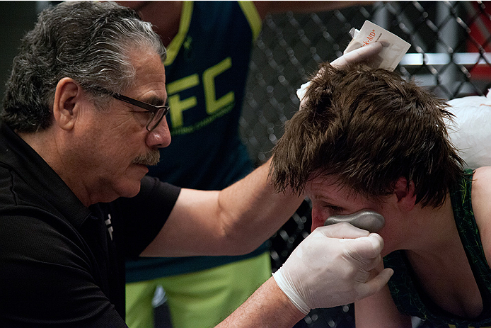 "LAS VEGAS, NV - AUGUST 5:  UFC cutman Jacob ""Stitch"" Duran helps Team Pettis fighter Aisling Daly after her fight against Pettis fighter Jessica Penne during filming of season twenty of The Ultimate Fighter on August 5, 2014 in Las Vegas, Nevada. (Photo b"