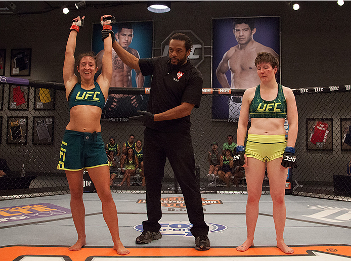 LAS VEGAS, NV - AUGUST 5:  (L-R) Team Pettis fighter Jessica Penne celebrates her win over team Pettis fighter Aisling Daly during filming of season twenty of The Ultimate Fighter on August 5, 2014 in Las Vegas, Nevada. (Photo by Brandon Magnus/Zuffa LLC/