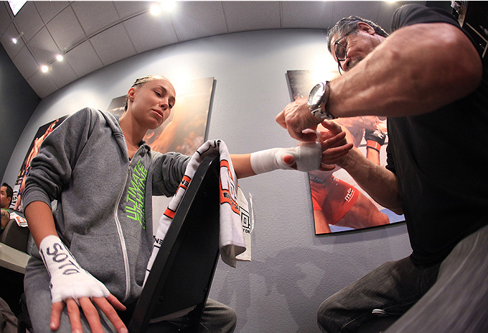 LAS VEGAS, NV - AUGUST 14:  Team Melendez fighter Rose Namajunas gets her hands wrapped before facing team Pettis fighter Randa Markos during filming of season twenty of The Ultimate Fighter on August 14, 2014 in Las Vegas, Nevada. (Photo by Brandon Magnu