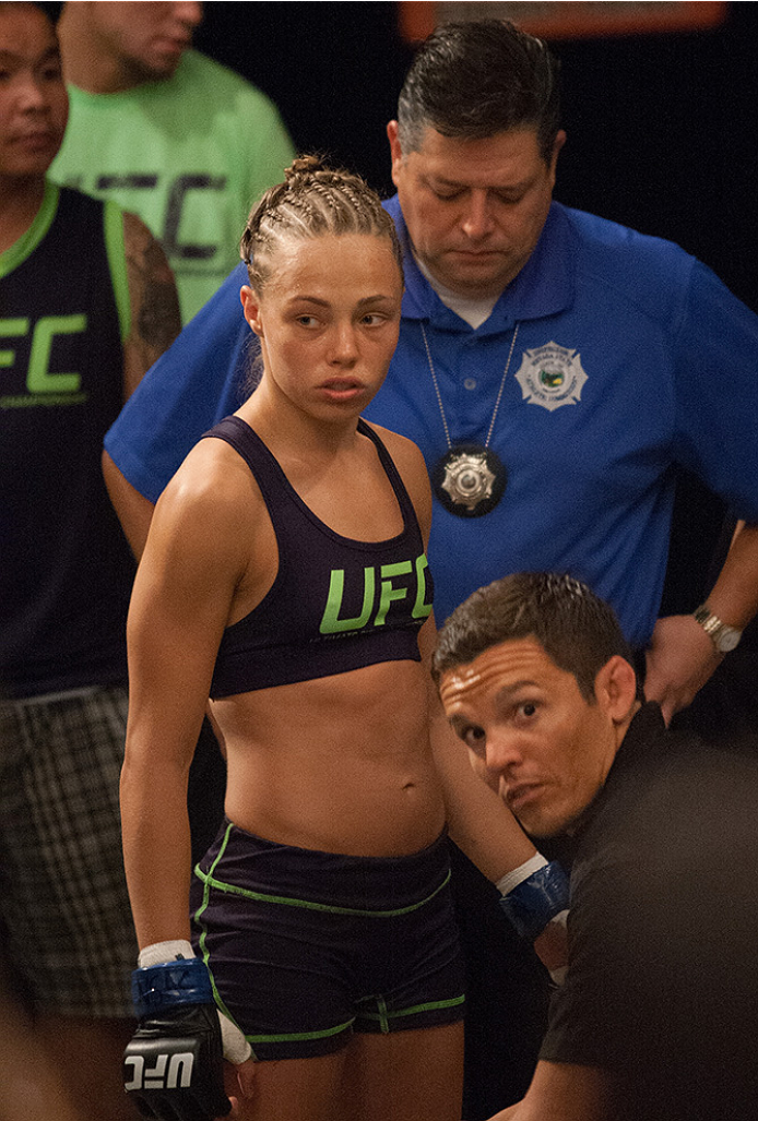 LAS VEGAS, NV - AUGUST 14:  Team Melendez fighter Rose Namajunas enters the Octagon before facing team Pettis fighter Randa Markos during filming of season twenty of The Ultimate Fighter on August 14, 2014 in Las Vegas, Nevada. (Photo by Brandon Magnus/Zu