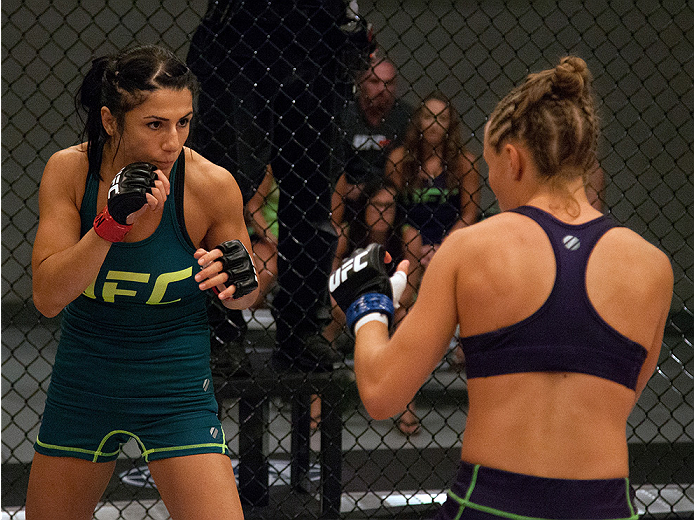 LAS VEGAS, NV - AUGUST 14:  (L-R) Team Pettis fighter Randa Markos circles the Octagon while facing team Melendez fighter Rose Namajunas during filming of season twenty of The Ultimate Fighter on August 14, 2014 in Las Vegas, Nevada. (Photo by Brandon Mag