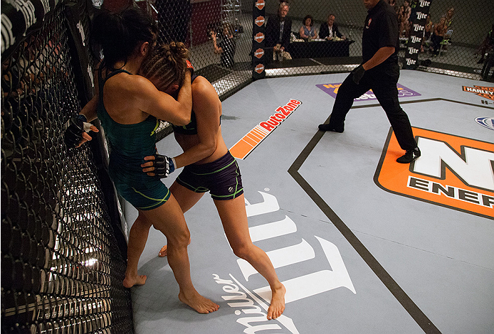LAS VEGAS, NV - AUGUST 14:  (R-L) Team Melendez fighter Rose Namajunas pushes team Pettis fighter Randa Markos up against the cage during filming of season twenty of The Ultimate Fighter on August 14, 2014 in Las Vegas, Nevada. (Photo by Brandon Magnus/Zu