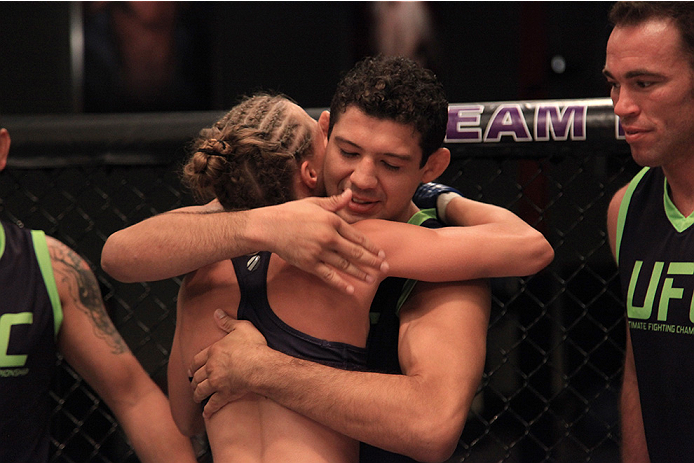 LAS VEGAS, NV - AUGUST 14:  Team Melendez fighter Rose Namajunas hugs her head coach Gilbert Melendez after submitting team Pettis fighter Randa Markos during filming of season twenty of The Ultimate Fighter on August 14, 2014 in Las Vegas, Nevada. (Photo
