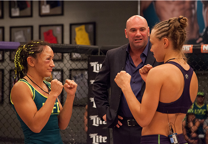 LAS VEGAS, NV - AUGUST 14:  (R-L) Team Melendez fighter Rose Namajunas faces off against team Pettis fighter Carla Esparza during filming of season twenty of The Ultimate Fighter on August 14, 2014 in Las Vegas, Nevada. (Photo by Brandon Magnus/Zuffa LLC/