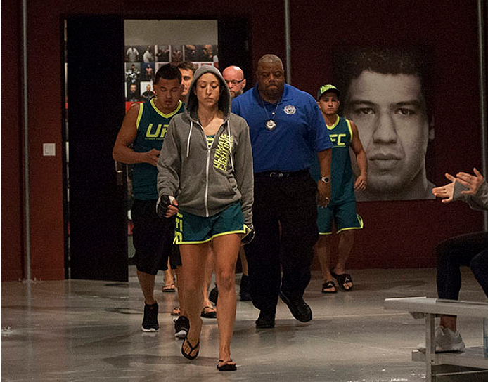 LAS VEGAS, NV - JULY 15:  Team Pettis fighter Jessica Penne prepares to enter the Octagon before facing team Melendez fighter Lisa Ellis during filming of season twenty of The Ultimate Fighter on July 15, 2014 in Las Vegas, Nevada. (Photo by Brandon Magnu