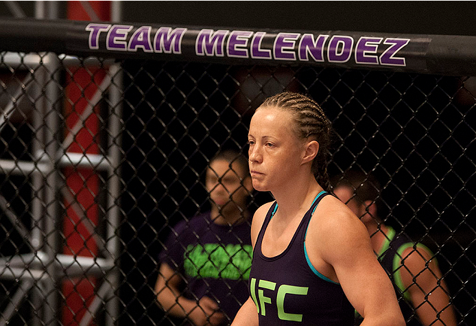 LAS VEGAS, NV - JULY 15:  Team Melendez fighter Lisa Ellis enters the Octagon before facing team Pettis fighter Jessica Penne during filming of season twenty of The Ultimate Fighter on July 15, 2014 in Las Vegas, Nevada. (Photo by Brandon Magnus/Zuffa LLC