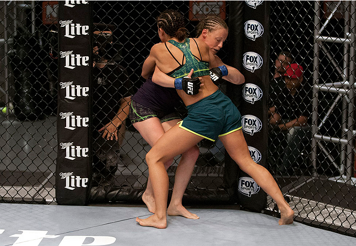 LAS VEGAS, NV - JULY 15:  (R-L) Team Pettis fighter Jessica Penne pushes team Melendez fighter Lisa Ellis up against the fence during filming of season twenty of The Ultimate Fighter on July 15, 2014 in Las Vegas, Nevada. (Photo by Brandon Magnus/Zuffa LL