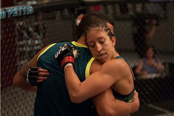 LAS VEGAS, NV - JULY 15:  Team Pettis fighter Jessica Penne hugs Head Coach Anthony Pettis after defeating team Melendez fighter Lisa Ellis during filming of season twenty of The Ultimate Fighter on July 15, 2014 in Las Vegas, Nevada. (Photo by Brandon Ma