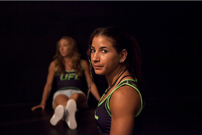 LAS VEGAS, NV - JULY 10:  Team Melendez fighters Tecia Torres and Heather Jo Clark wait to watch teammate Lisa Ellis fight team Pettis fighter Jessica Penne during filming of season twenty of The Ultimate Fighter on July 10, 2014 in Las Vegas, Nevada. (Ph