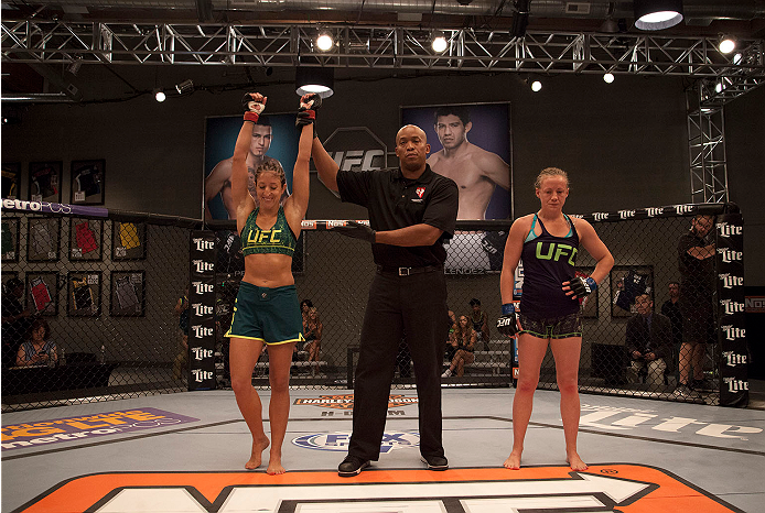 LAS VEGAS, NV - JULY 15:  Team Pettis fighter Jessica Penne celebrates her victory over team Melendez fighter Lisa Ellis during filming of season twenty of The Ultimate Fighter on July 15, 2014 in Las Vegas, Nevada. (Photo by Brandon Magnus/Zuffa LLC/Zuff