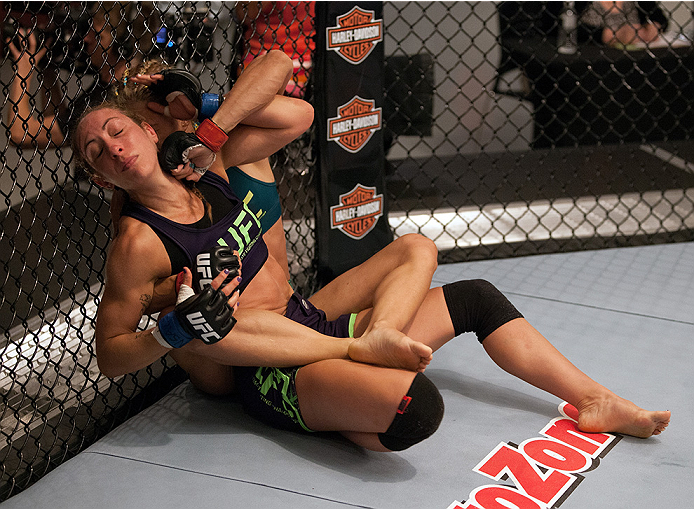 LAS VEGAS, NV - JULY 18:  (Top) Team Pettis fighter Felice Herrig controls the body and punches team Melendez fighter Heather Jo Clark during filming of season twenty of The Ultimate Fighter on July 18, 2014 in Las Vegas, Nevada. (Photo by Brandon Magnus/