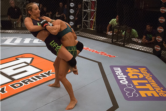 LAS VEGAS, NV - JULY 18:  (L-R) Team Melendez fighter Heather Jo Clark attempts to submit team Pettis fighter Felice Herrig during filming of season twenty of The Ultimate Fighter on July 18, 2014 in Las Vegas, Nevada. (Photo by Brandon Magnus/Zuffa LLC/Z