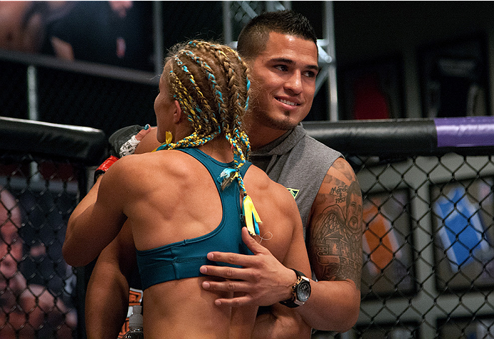 LAS VEGAS, NV - JULY 18:  Team Pettis fighter Felice Herrig hugs Head Coach Anthony Pettis after her submission victory over team Melendez fighter Heather Jo Clark during filming of season twenty of The Ultimate Fighter on July 18, 2014 in Las Vegas, Neva