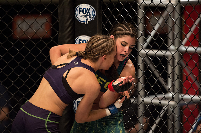 LAS VEGAS, NV - JULY 28:  (L-R) Team Melendez fighter Rose Namjunas pushes team Pettis fighter Alex Chambers up against the cage during filming of season twenty of The Ultimate Fighter on July 28, 2014 in Las Vegas, Nevada. (Photo by Brandon Magnus/Zuffa