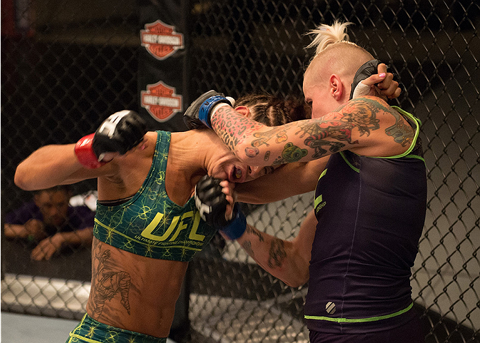 LAS VEGAS, NV - JULY 28:  (R-L) Team Melendez fighter Bec Rawlings exchanges punches with team Pettis fighter Tecia Torres during filming of season twenty of The Ultimate Fighter on July 28, 2014 in Las Vegas, Nevada. (Photo by Brandon Magnus/Zuffa LLC/Zu