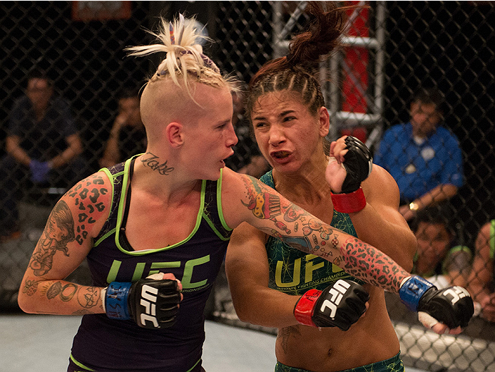 LAS VEGAS, NV - JULY 28:  (L-R) Team Melendez fighter Bec Rawlings exchanges punches with team Pettis fighter Tecia Torres during filming of season twenty of The Ultimate Fighter on July 28, 2014 in Las Vegas, Nevada. (Photo by Brandon Magnus/Zuffa LLC/Zu