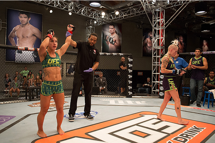 LAS VEGAS, NV - JULY 28:  (L-R) Team Pettis fighter Tecia Torres celebrates her win over team Melendez fighter Bec Rawlings during filming of season twenty of The Ultimate Fighter on July 28, 2014 in Las Vegas, Nevada. (Photo by Brandon Magnus/Zuffa LLC/Z