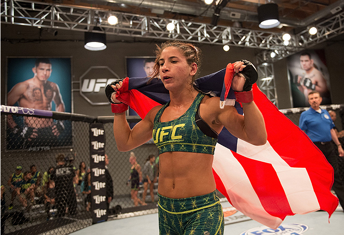 LAS VEGAS, NV - JULY 28:  Team Pettis fighter Tecia Torres celebrates her win over team Melendez fighter Bec Rawlings during filming of season twenty of The Ultimate Fighter on July 28, 2014 in Las Vegas, Nevada. (Photo by Brandon Magnus/Zuffa LLC/Zuffa L