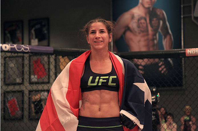 LAS VEGAS, NV - JULY 8:  Team Melendez fighter Tecia Torres waits to hear the results after fighting team Pettis fighter Randa Markos during filming of season twenty of The Ultimate Fighter on July 8, 2014 in Las Vegas, Nevada. (Photo by Brandon Magnus/Zu