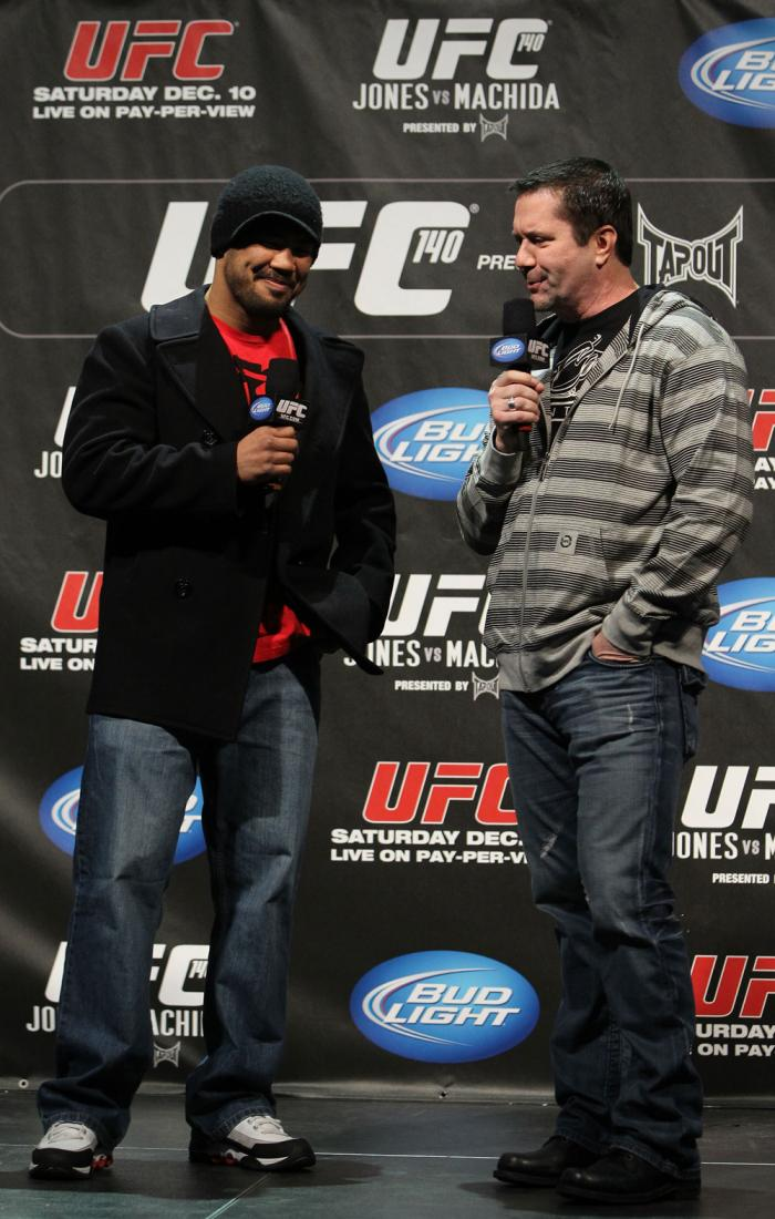TORONTO, ON - DECEMBER 09:  (L-R) UFC Middleweight contender Mark Munoz and UFC commentator Mike Goldberg interacts with fans during a Q&A session before the UFC 140 Official Weigh-in at the Air Canada Centre on December 9, 2011 in Toronto, Canada.  (Phot