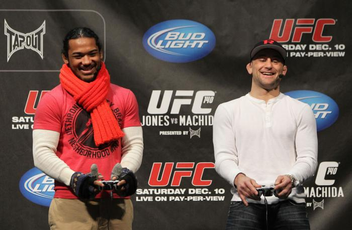 TORONTO, ON - DECEMBER 09:  (R-L) UFC Lightweight Champion Frankie Edgar and challenger Benson Henderson battle each other on the UFC Undisputed 3 videogame before the UFC 140 Official Weigh-in at the Air Canada Centre on December 9, 2011 in Toronto, Cana