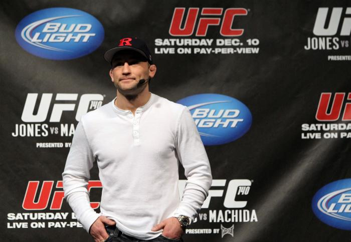 TORONTO, ON - DECEMBER 09:  UFC Lightweight Champion Frankie Edgar stands on stage after defeating Benson Henderson on the UFC Undisputed 3 videogame before the UFC 140 Official Weigh-in at the Air Canada Centre on December 9, 2011 in Toronto, Canada.  (P