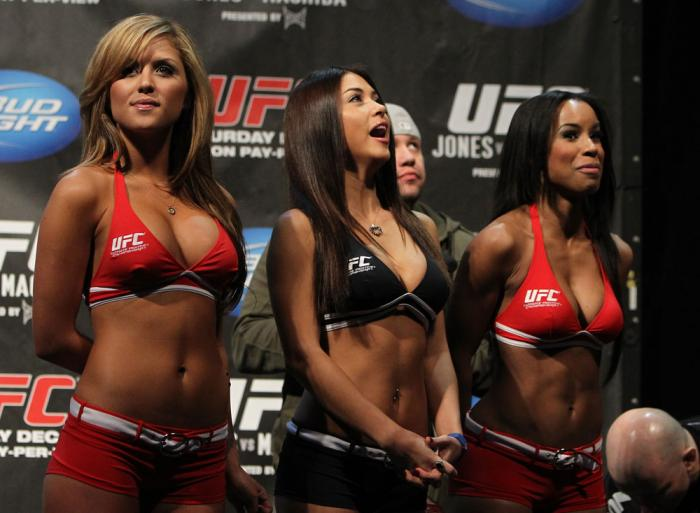 TORONTO, ON - DECEMBER 09:  (L-R) UFC Octagon Girls Brittney Palmer, Arianny Celeste, and Chandella Powell turn their backs to the scale as Mitch Clarke weighs in during the UFC 140 Official Weigh-in at the Air Canada Centre on December 9, 2011 in Toronto