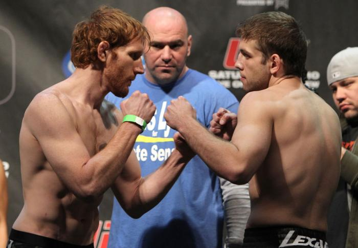 TORONTO, ON - DECEMBER 09:  (L-R) Lightweight opponentsMark Bocek and Nik Lentz face off after weighing in during the UFC 140 Official Weigh-in at the Air Canada Centre on December 9, 2011 in Toronto, Canada.  (Photo by Josh Hedges/Zuffa LLC/Zuffa LLC via