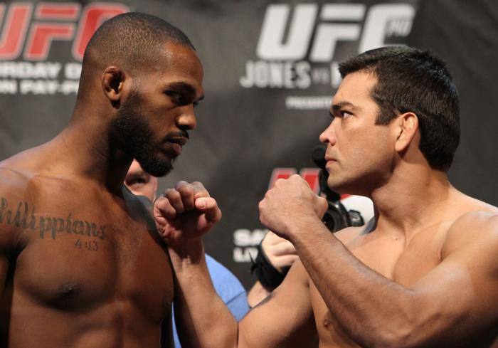"""TORONTO, ON - DECEMBER 09:  (L-R) UFC Light Heavyweight Champion Jon """"Bones"""" Jones and challenger Lyoto Machida face off after weighing in during the UFC 140 Official Weigh-in at the Air Canada Centre on December 9, 2011 in Toronto, Canada.  (Photo by Jos"""