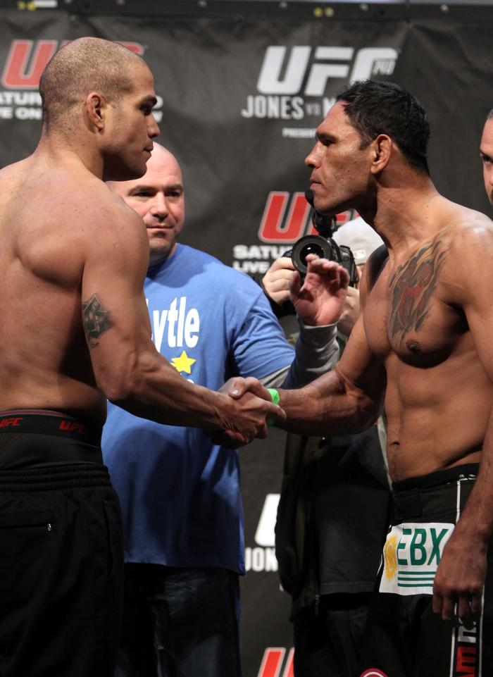 """TORONTO, ON - DECEMBER 09:  (L-R) Light Heavyweight opponents Tito Ortiz and Antonio Rogerio """"Minotoro"""" Nogueira face off after weighing in during the UFC 140 Official Weigh-in at the Air Canada Centre on December 9, 2011 in Toronto, Canada.  (Photo by Jo"""