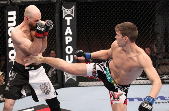 LAS VEGAS, NV - FEBRUARY 04:  Stephen Thompson (right) kicks Dan Stittgen during the UFC 143 event at Mandalay Bay Events Center on February 4, 2012 in Las Vegas, Nevada.  (Photo by Nick Laham/Zuffa LLC/Zuffa LLC via Getty Images) *** Local Caption *** St