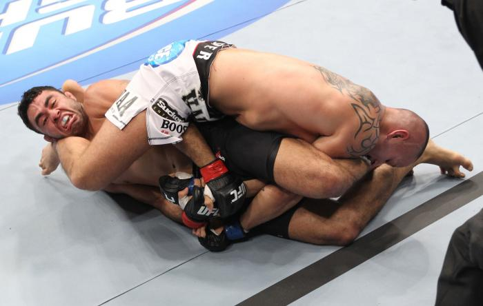 LAS VEGAS, NV - FEBRUARY 04:  Rafael Natal (left) attempts to submit Michael Kuiper during the UFC 143 event at Mandalay Bay Events Center on February 4, 2012 in Las Vegas, Nevada.  (Photo by Nick Laham/Zuffa LLC/Zuffa LLC via Getty Images) *** Local Capt