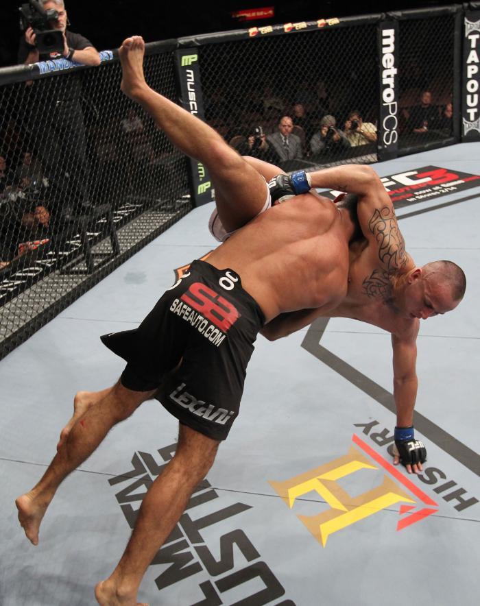 LAS VEGAS, NV - FEBRUARY 04:  Rafael Natal (black shorts) slams Michael Kuiper down to the canvas during the UFC 143 event at Mandalay Bay Events Center on February 4, 2012 in Las Vegas, Nevada.  (Photo by Nick Laham/Zuffa LLC/Zuffa LLC via Getty Images)