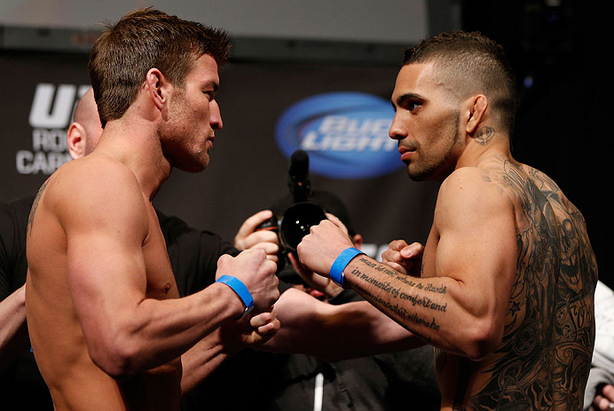 ANAHEIM, CA - FEBRUARY 22:  (L-R) Opponents Sam Stout and Caros Fodor face off during the UFC 157 weigh-in at Honda Center on February 22, 2013 in Anaheim, California.  (Photo by Josh Hedges/Zuffa LLC/Zuffa LLC via Getty Images)