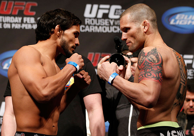 ANAHEIM, CA - FEBRUARY 22:  (L-R) Opponents Dennis Bermudez and Matt Grice face off during the UFC 157 weigh-in at Honda Center on February 22, 2013 in Anaheim, California.  (Photo by Josh Hedges/Zuffa LLC/Zuffa LLC via Getty Images)