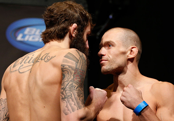 ANAHEIM, CA - FEBRUARY 22:  (L-R) Opponents Michael Chiesa and Anton Kuivanen face off during the UFC 157 weigh-in at Honda Center on February 22, 2013 in Anaheim, California.  (Photo by Josh Hedges/Zuffa LLC/Zuffa LLC via Getty Images)