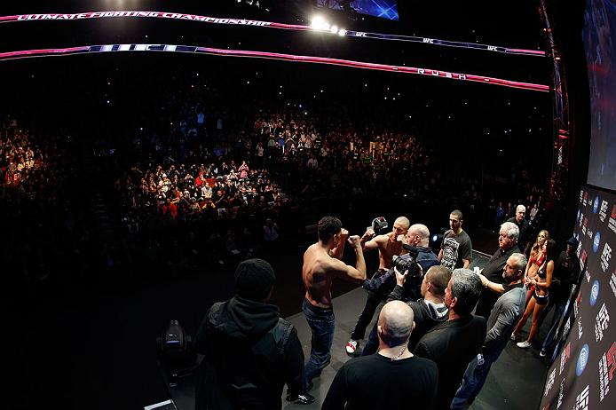 MONTREAL, QC - MARCH 15:  (R-L) Opponents Georges St-Pierre and Nick Diaz face off during the UFC 158 weigh-in at Bell Centre on March 15, 2013 in Montreal, Quebec, Canada.  (Photo by Josh Hedges/Zuffa LLC/Zuffa LLC via Getty Images)