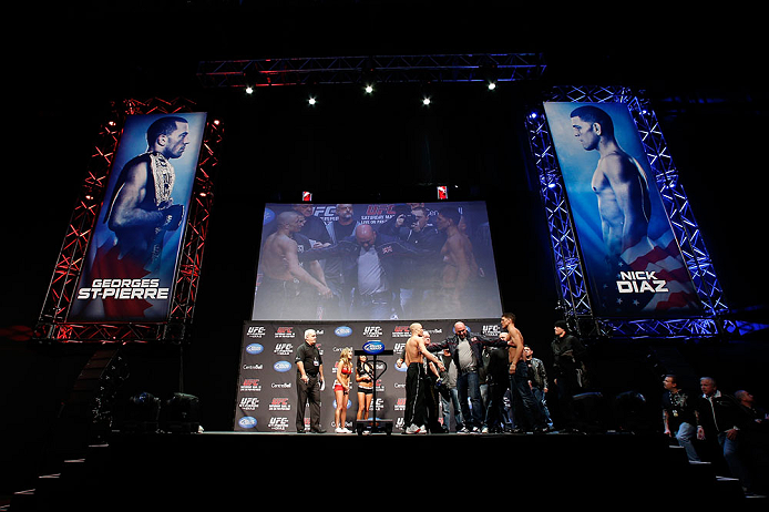 MONTREAL, QC - MARCH 15:  (L-R) Opponents Georges St-Pierre and Nick Diaz are separated by UFC president Dana White during the UFC 158 weigh-in at Bell Centre on March 15, 2013 in Montreal, Quebec, Canada.  (Photo by Josh Hedges/Zuffa LLC/Zuffa LLC via Ge