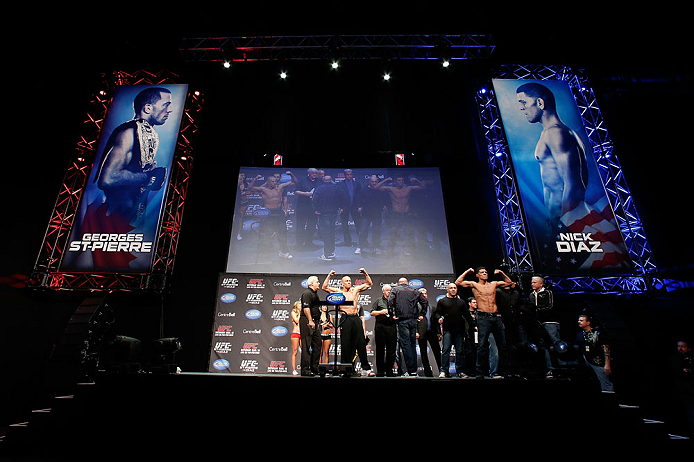 MONTREAL, QC - MARCH 15:  (L-R) Opponents Georges St-Pierre and Nick Diaz pose for the fans during the UFC 158 weigh-in at Bell Centre on March 15, 2013 in Montreal, Quebec, Canada.  (Photo by Josh Hedges/Zuffa LLC/Zuffa LLC via Getty Images)