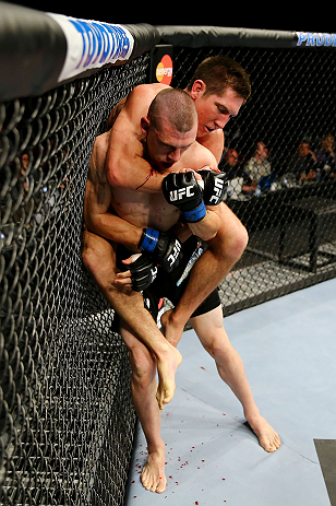 NEWARK, NJ - APRIL 27:  Steven Siler (top) battles against Kurt Holobaugh (bottom) in their featherweight bout during the UFC 159 event at the Prudential Center on April 27, 2013 in Newark, New Jersey.  (Photo by Al Bello/Zuffa LLC/Zuffa LLC Via Getty Ima