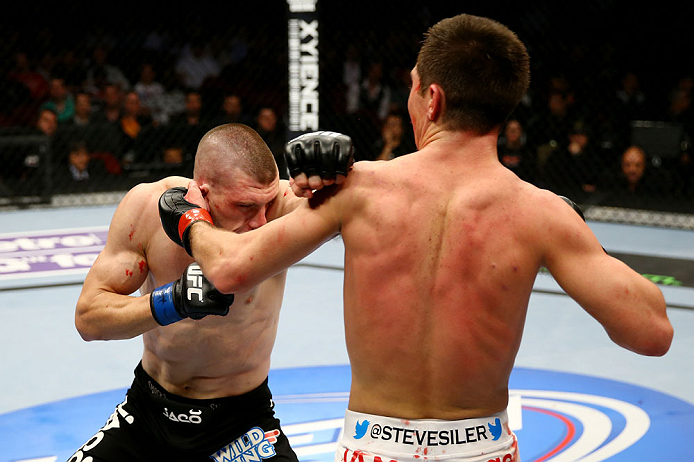 NEWARK, NJ - APRIL 27: (L-R) Kurt Holobaugh throws a punch against Steven Siler in their featherweight bout during the UFC 159 event at the Prudential Center on April 27, 2013 in Newark, New Jersey.  (Photo by Al Bello/Zuffa LLC/Zuffa LLC Via Getty Images