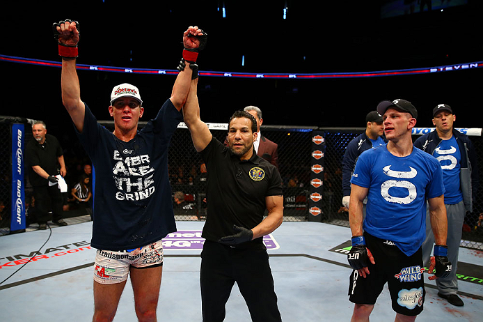 NEWARK, NJ - APRIL 27:  Steven Siler (L) is announced winner by unanimous decision in his featherweight bout against Kurt Holobaugh (R) during the UFC 159 event at the Prudential Center on April 27, 2013 in Newark, New Jersey.  (Photo by Al Bello/Zuffa LL
