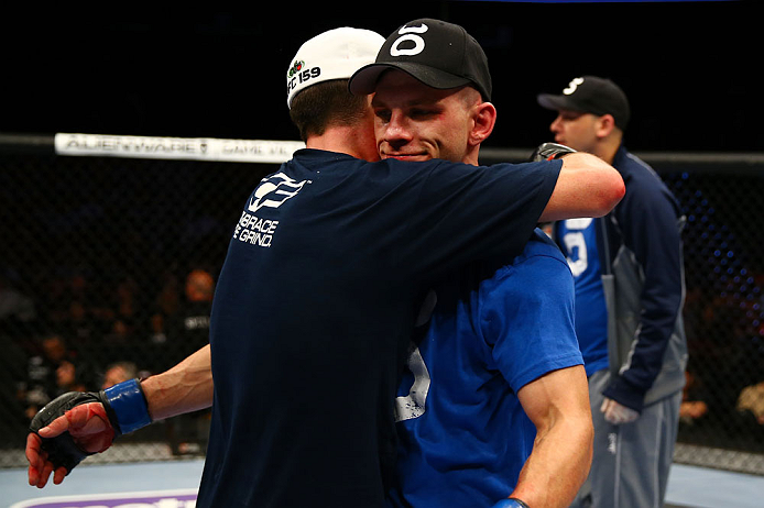 NEWARK, NJ - APRIL 27:  Steven Siler (L) is hugs opponent Kurt Holobaugh (R) after winning their featherweight bout by unanimous decision during the UFC 159 event at the Prudential Center on April 27, 2013 in Newark, New Jersey.  (Photo by Al Bello/Zuffa