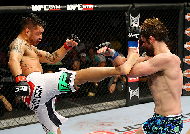 NEWARK, NJ - APRIL 27:  Cody McKenzie (R) blocks a kick from Leonard Garcia (L) in their featherweight bout during the UFC 159 event at the Prudential Center on April 27, 2013 in Newark, New Jersey.  (Photo by Al Bello/Zuffa LLC/Zuffa LLC Via Getty Images