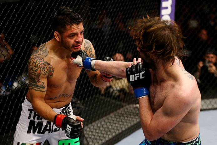 NEWARK, NJ - APRIL 27:  Cody McKenzie (R) punches Leonard Garcia (L) in their featherweight bout during the UFC 159 event at the Prudential Center on April 27, 2013 in Newark, New Jersey.  (Photo by Al Bello/Zuffa LLC/Zuffa LLC Via Getty Images)