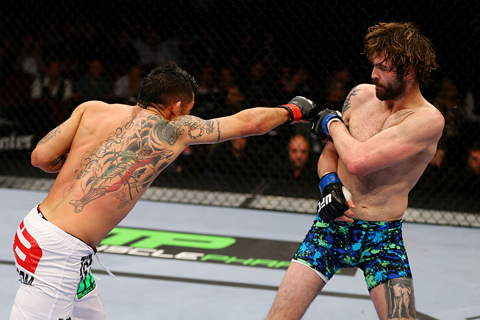 NEWARK, NJ - APRIL 27:  Leonard Garcia (L) throws a punch against Cody McKenzie (R) in their featherweight bout during the UFC 159 event at the Prudential Center on April 27, 2013 in Newark, New Jersey.  (Photo by Al Bello/Zuffa LLC/Zuffa LLC Via Getty Im