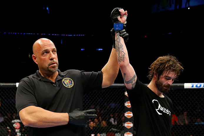 NEWARK, NJ - APRIL 27: Referee Dan Miragliotta announces Cody McKenzie winner by unanimous decision against Leonard Garcia in their featherweight bout during the UFC 159 event at the Prudential Center on April 27, 2013 in Newark, New Jersey.  (Photo by Al