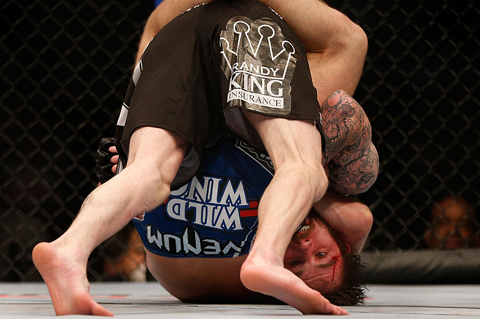 NEWARK, NJ - APRIL 27:   Johny Bedford is defeated by Bryan Caraway by submission due to a guillotine choke in their bantamweight fight during the UFC 159 event at the Prudential Center on April 27, 2013 in Newark, New Jersey.  (Photo by Josh Hedges/Zuffa